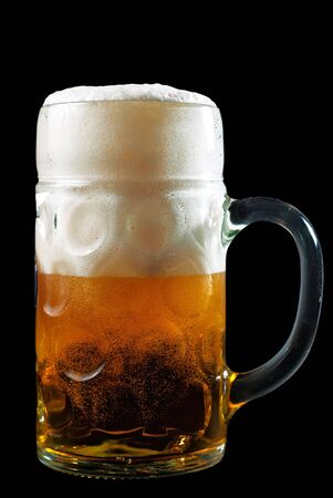 a beer mug filled with beer and foam photo