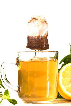 theine: tea glass with tea bags and lemon