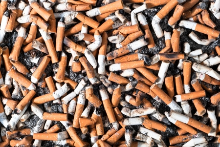 benzene: many filter cigarette butts background