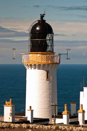 endpoint: lighthouse at the sea against the blue sky