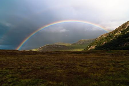 colorful rainbow at the sky over a meadow Stock Photo - 8063687