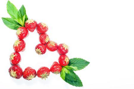 strawberry heart isolated on white background photo