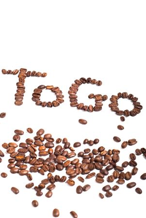 to go written with beans on white background photo