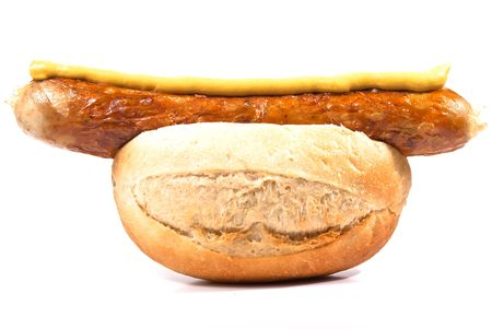 Sausage in a bun on a white background photo