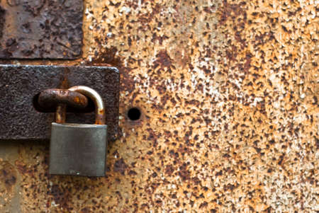 Old rusty padlock for background photo
