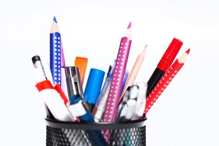 a mug full of pencils on white background photo