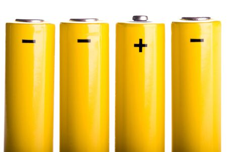 four yellow batteries with plus and minus standing Stock Photo - 9052385