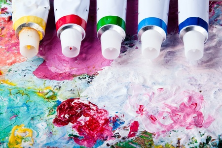 brush drawing: colorful color mixing palette of different color tubes