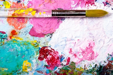 colorful color mixing palette with brush and text space below photo