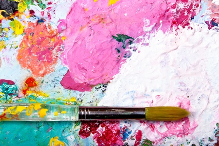 color mixing: colorful color mixing palette with brush and text at top Stock Photo