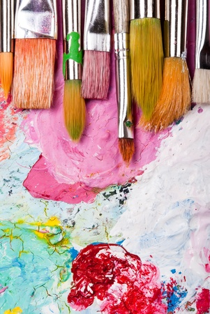 color mixing: colorful color mixing palette with many brushes and text area below Stock Photo