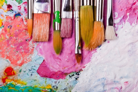 brush painting: colorful color mixing palette with many brushes and text area below Stock Photo