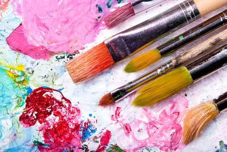 the sides: colorful color mixing palette with many brushes and text at sides Stock Photo