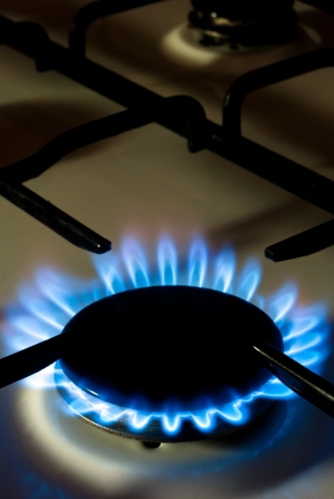 a flame burning on a gas stove in the kitchen Stock Photo - 9052429