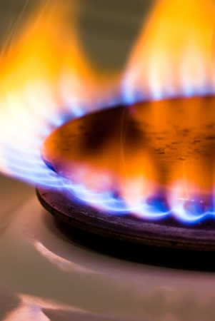 a flame burning on a gas stove in the kitchen Stock Photo