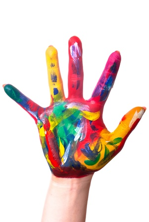 a painted colorful hand upright before a white background photo