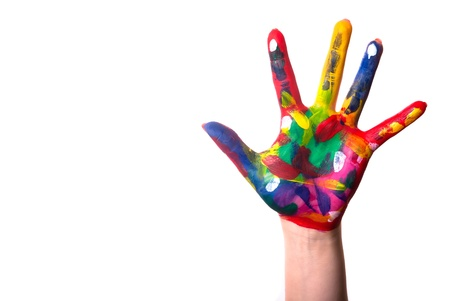 a painted colorful hand against a white background and text space photo