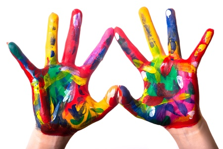children painting: two painted colorful hands forming a heart on a white background