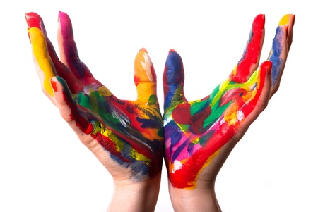 games hand: two painted colorful hands form a cup in front of white background