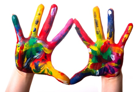 two painted colorful hands against white background photo