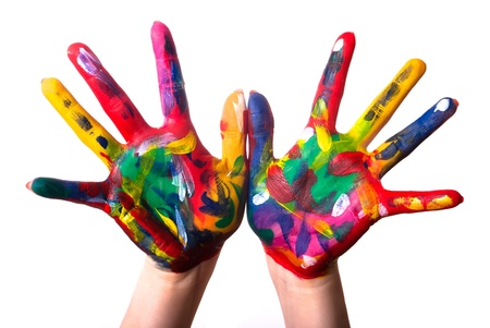 children painting: two painted colorful hands against white background