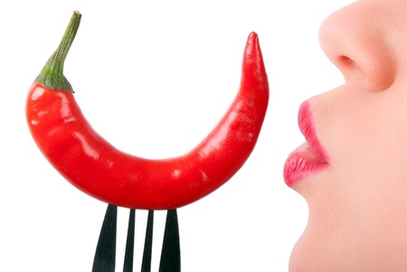 hot peppers: a red pepper on a fork is kissed