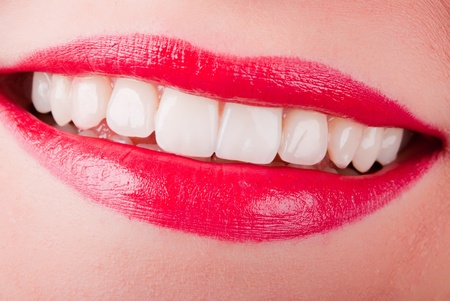 a smiling mouth with red lips and white teeth photo