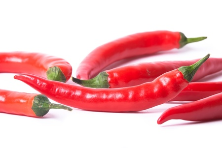 red peppers: many red peppers on a white background optional