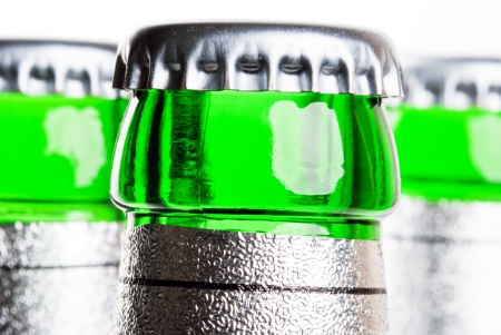 bottlenecks: three green bottlenecks of beer bottles in front of white background Stock Photo