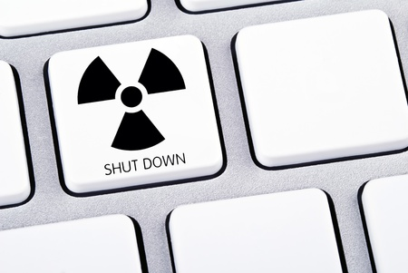 Key on keyboard for shut down nuclear energy Stock Photo - 9407453