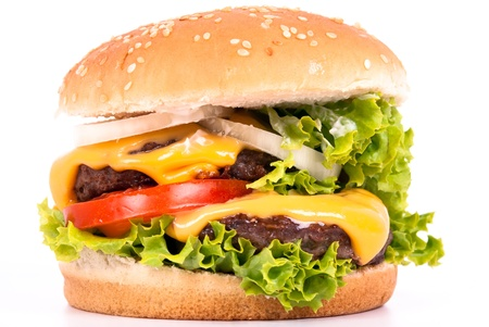 a cheeseburger with tomato, salad and onions on white background photo