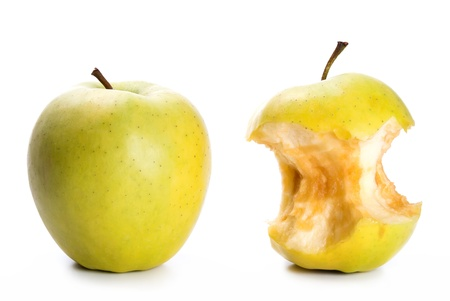 an apple and an apple core in front of white background photo