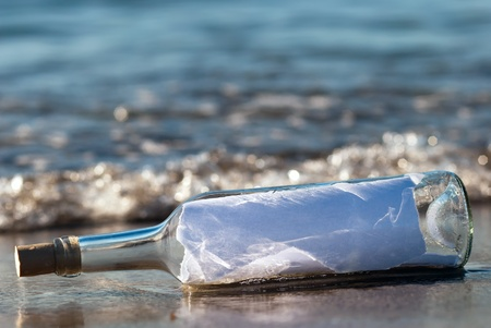 a message in a bottle with news in the surge Stock Photo