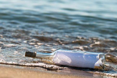 importantly: a message in a bottle with news in the surge Stock Photo