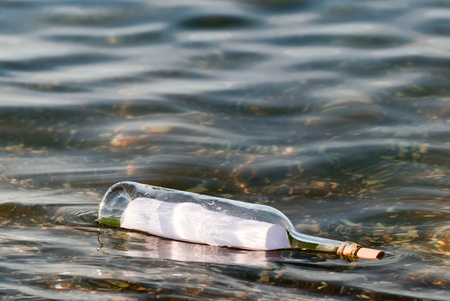 a message in a bottle swims in the water photo