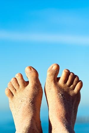 sandy feet on the beach before blue sky Stock Photo - 9979447