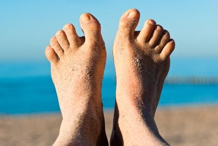 sandy feet on the beach before blue sky Stock Photo - 9979446
