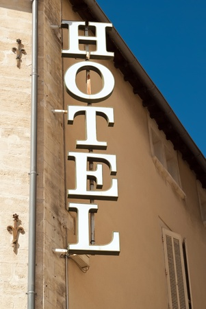 hostel: a white hotel sign