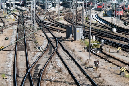 put away: a signal box with many rails and trains Stock Photo