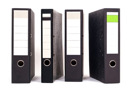 filing system: four files stand side by side on white background Stock Photo
