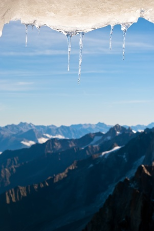 many icicles hang before snow covered mountain landscape Stock Photo - 11408419