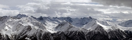 snowy mountains with cloudy sky panorama Stock Photo - 13060712