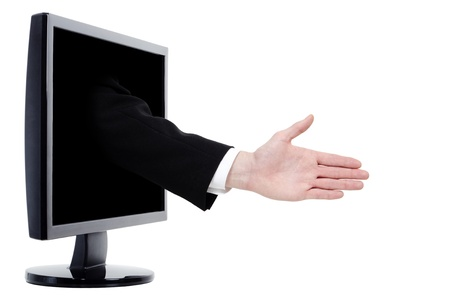 an arm with outstretched hand comes out of a monitor photo