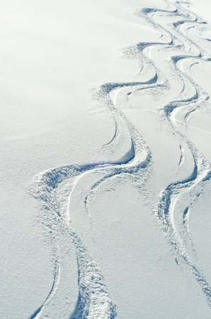 two ski traces side by side in the snow Stock Photo