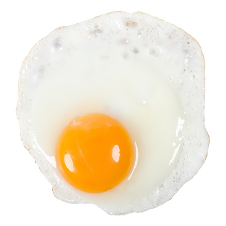 a fried egg isolated before white background photo