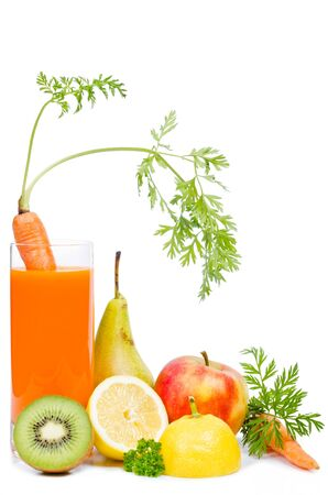 a glass with carrot juice and fruit before white background photo
