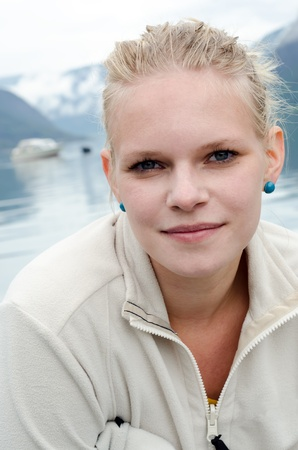 fleece: young blond woman before a fjord in Norway