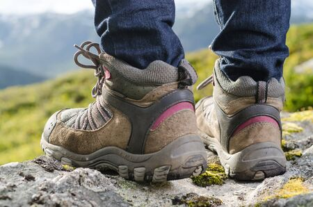 tramping: two tramping boots bevore mountain landscape