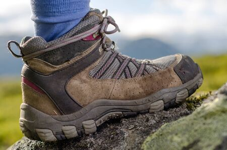tramping: tramping boot bevore mountain landscape Stock Photo