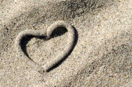 heart in sand: a sandworm heap at the beach formes like a heart